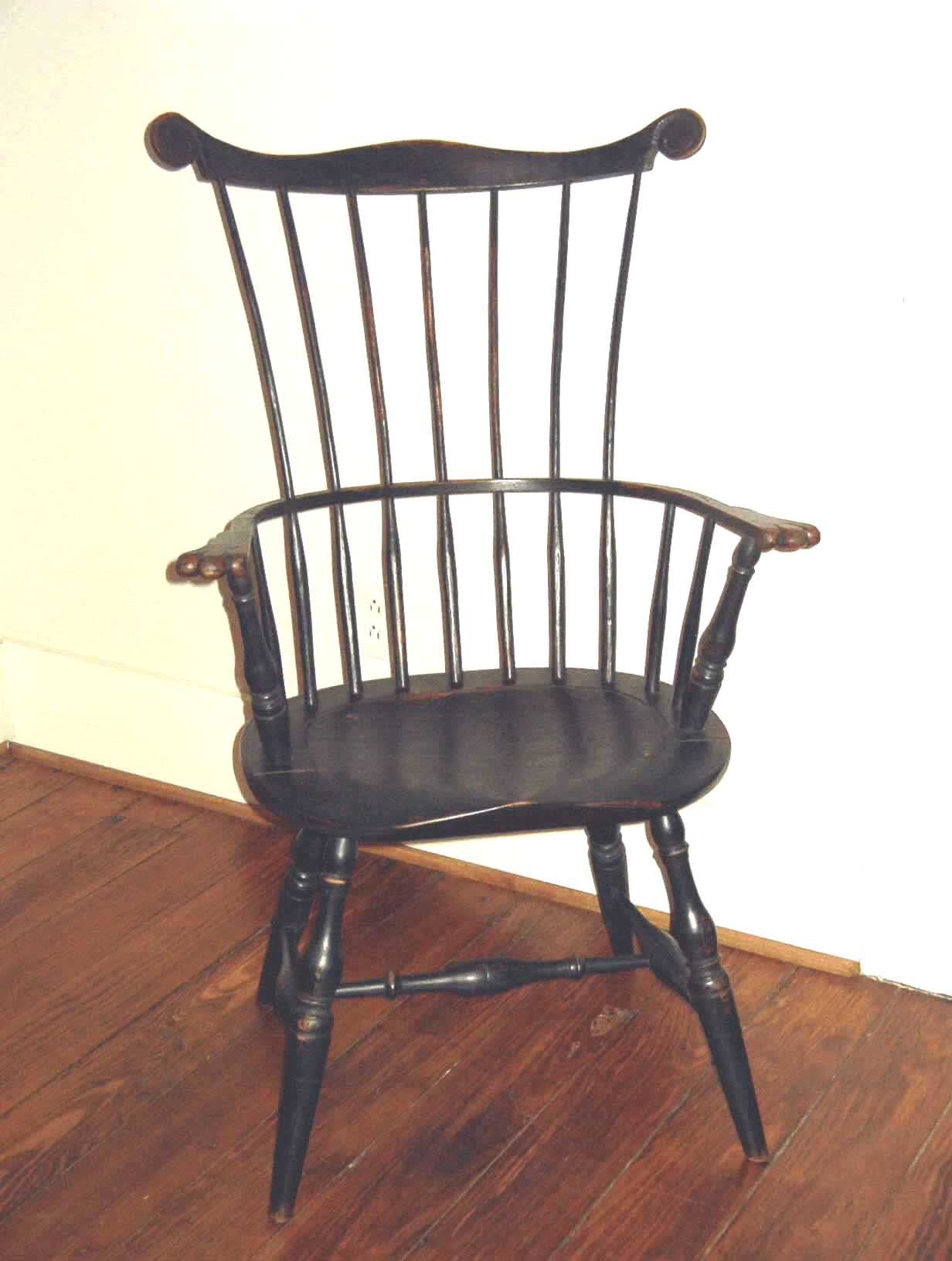 Also Referred To As Comb Back. Features An Oval Seat Like The Sack Back But  With A Taller Back Having Seven Shaved Spindles Piercing A Steam Bent Arm  ...